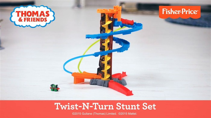 Fisher-Price Thomas & Friends stunt set on a bare floor.