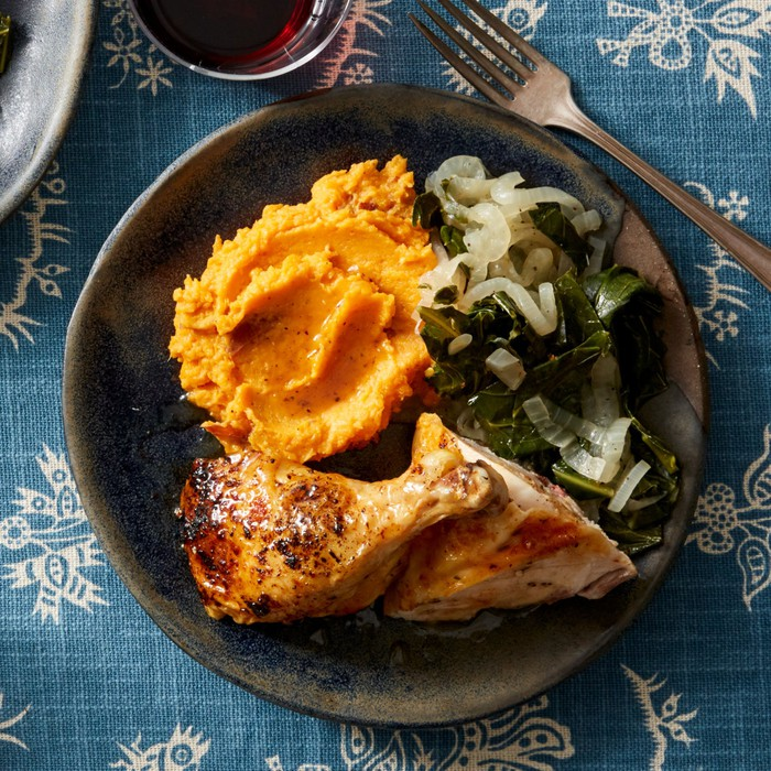A plate of roast chicken and mashed sweet potatoes