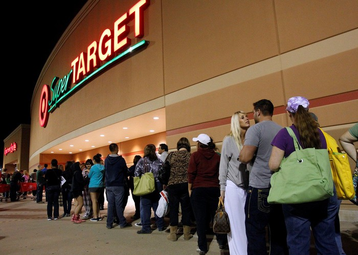 Customers line up for Black Friday outside of a Target store.