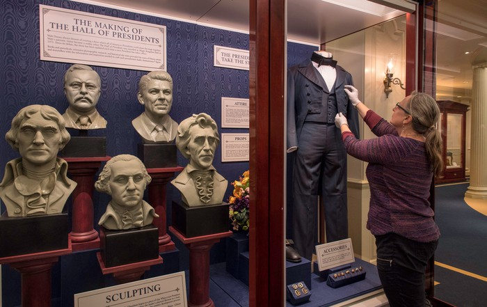 An exhibit outside of The Hall of President's theater detailing the history of the attraction.