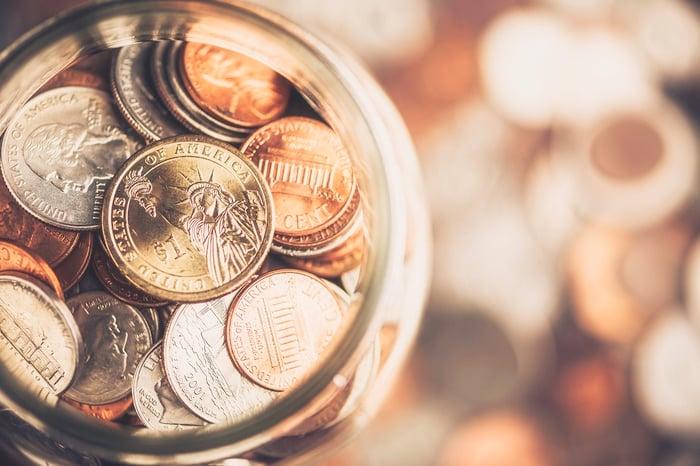 U.S. coins in a jar.