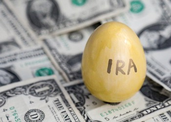 IRA golden egg on top of money