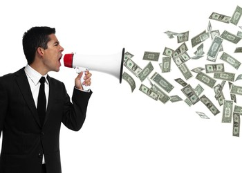 Businessman yelling into megaphone with money coming out of it.
