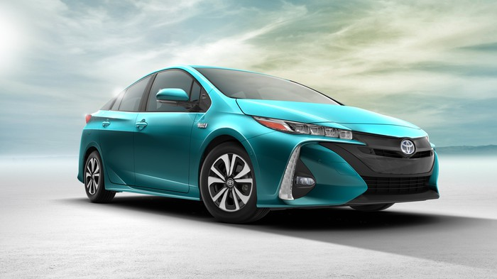 A green 2017 Toyota Prius Prime plug-in hybrid sedan.