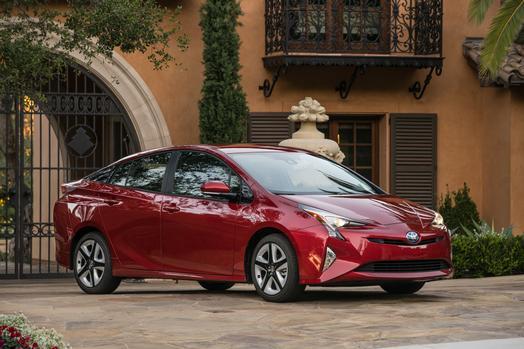 A red 2017 Toyota Prius hybrid sedan.