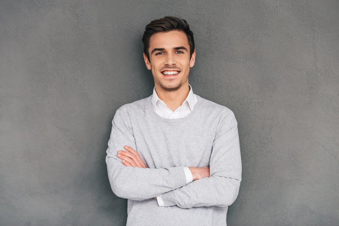 Smiling man against a gray background