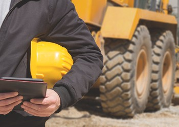 Construction worker with tablet