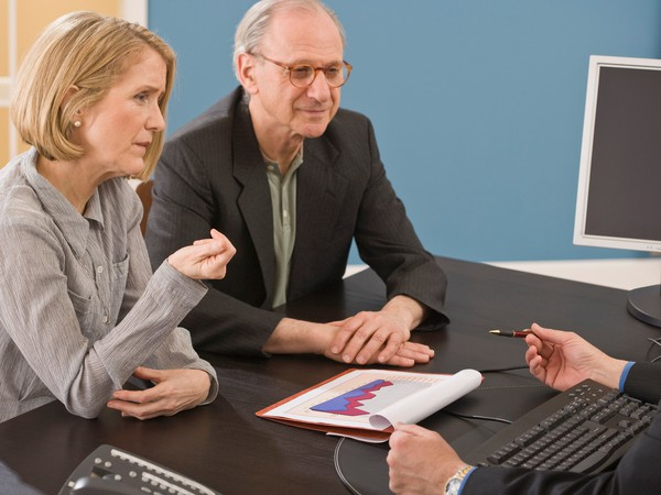 Senior couple investing discussion -- GettyImages-81284593