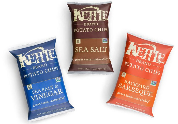 Three bags of Kettle Brand potato chips in different flavors