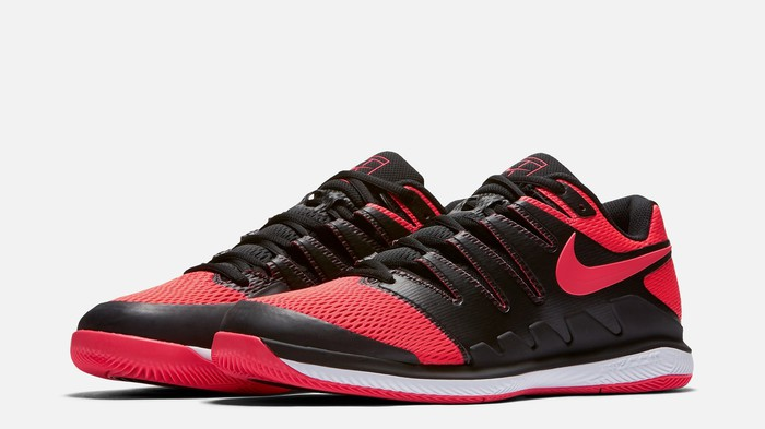 Red, black, and white Nike tennis shoe