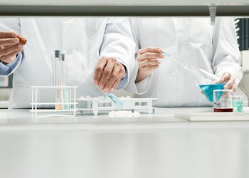 Scientists side by side with test tubes