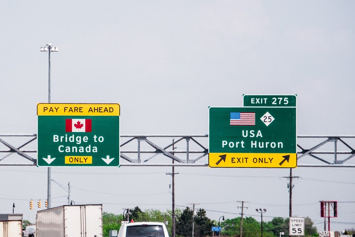 Highway signs to Canada and exit to USA