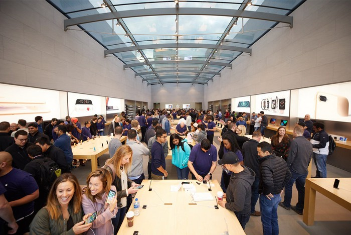 Apple store interior flooded with customers during iPhone X launch.