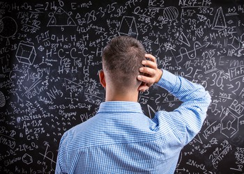 confused man staring at blackboard with complicated equations formulas math (1)