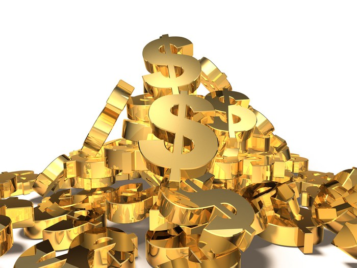 A pile of gold U.S. dollar signs.