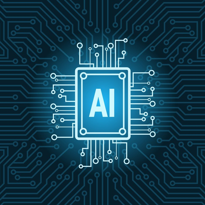 """Chip with """"AI"""" on it in a circuit board."""