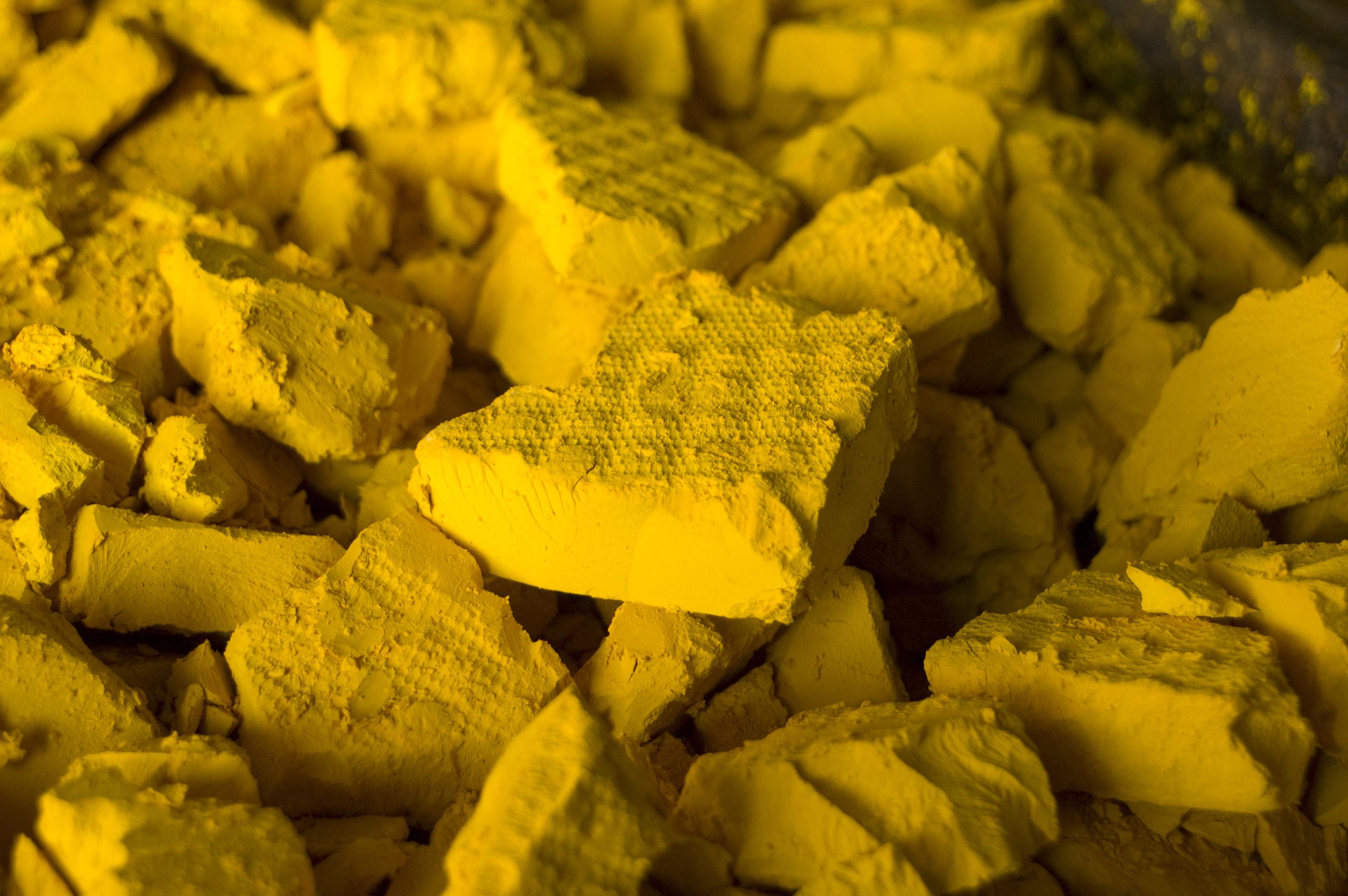 Solid yellow uranium cakes.