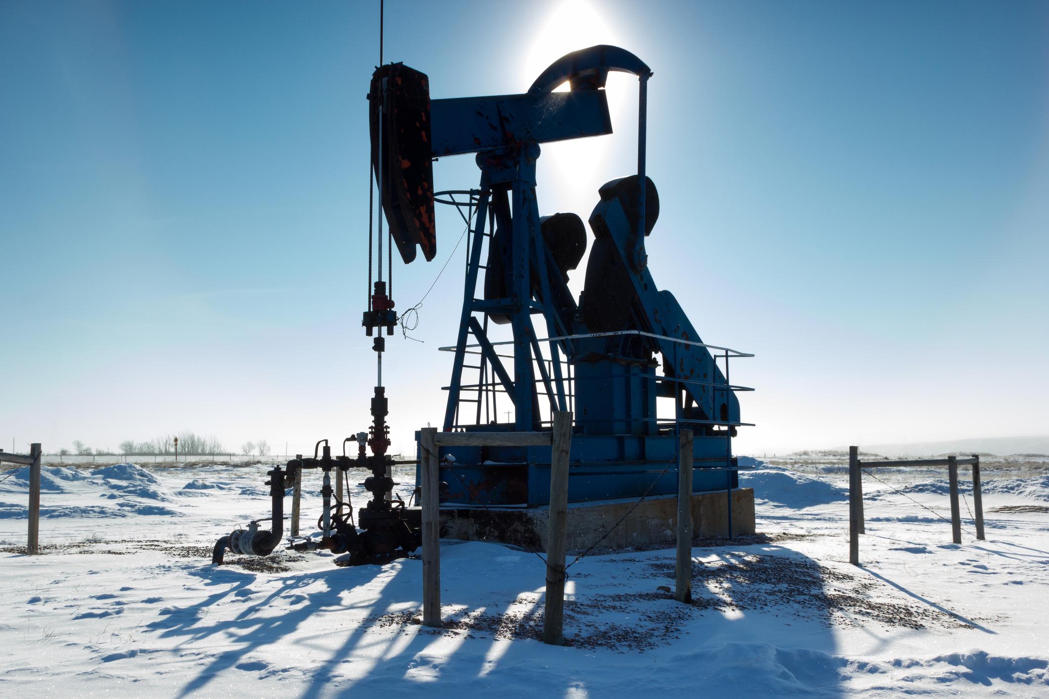 An oil pump in the snow.