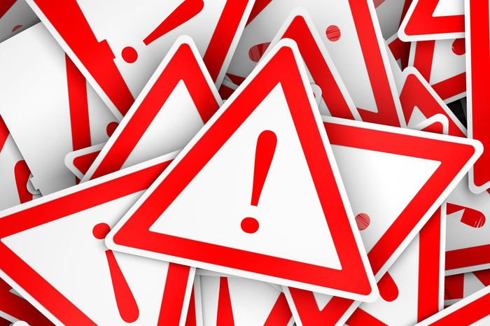 A pile of danger signs: white triangles outlined in red with an exclamation mark in the middle.