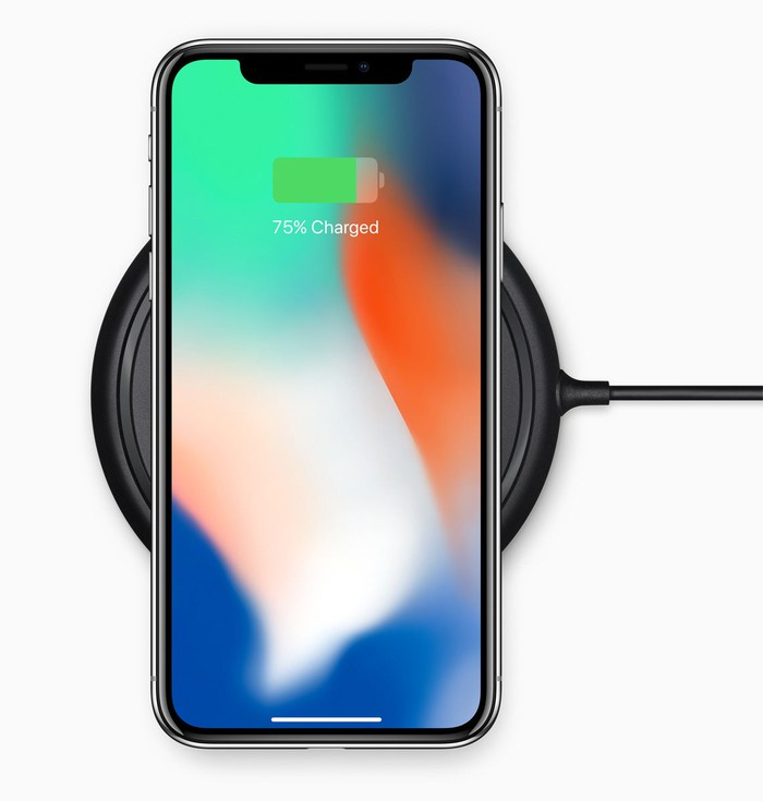 iPhone X on a wireless charging dock.