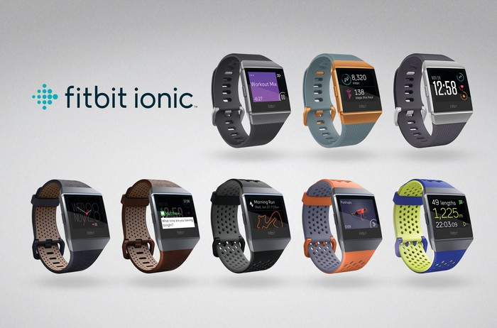 Eight Fitbit Ionic smartwatches with different faces and bands.