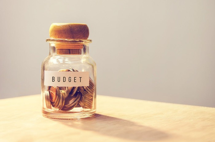 "Coin jar labeled ""budget"""