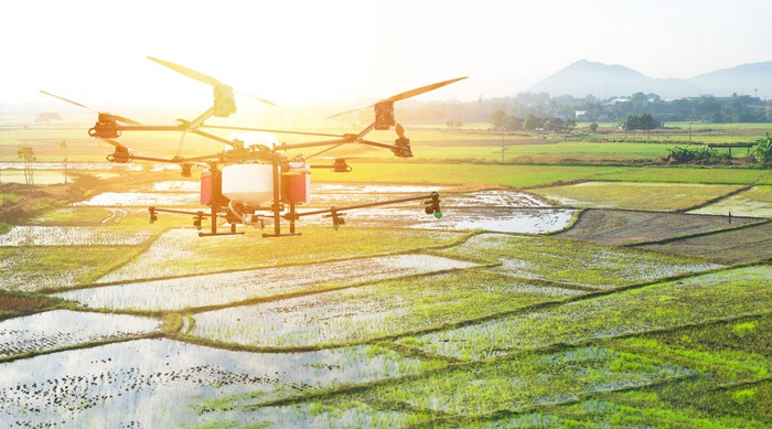 Drone flying over agriculture fields