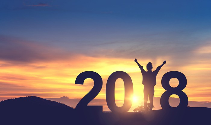 2018 with sunset in background and triumphant person replacing the 1.