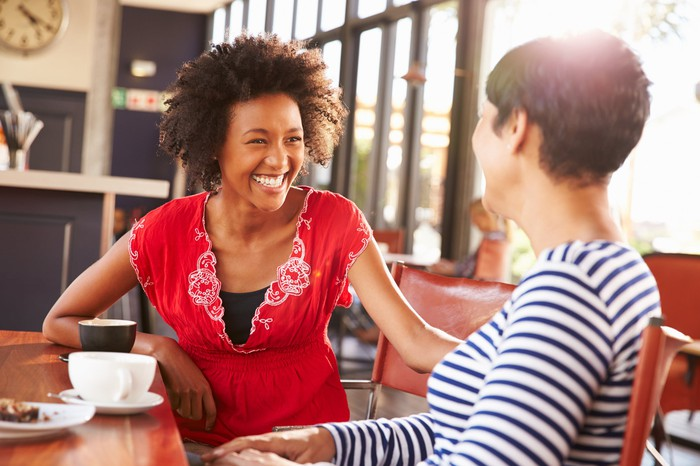 Two females talking and laughing