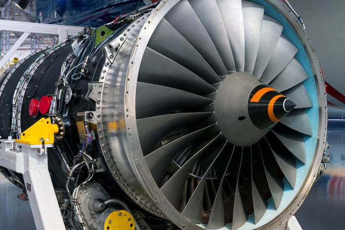 A jet engine being inspected.