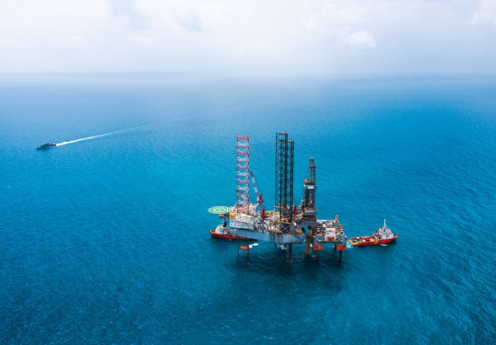 Offshore drilling rig in open water.