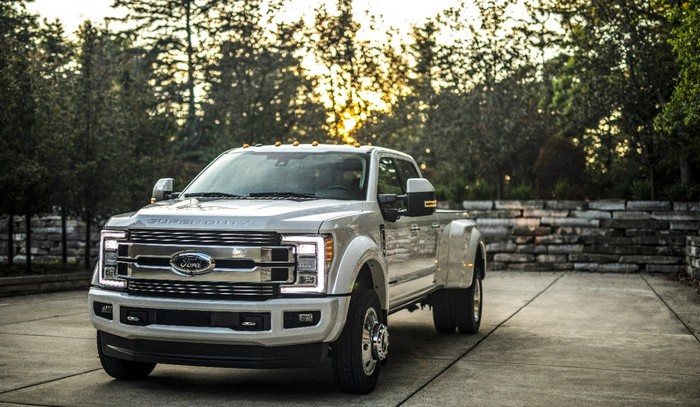 Ford's 2018 A silver F-Series Super Duty parked on a tree-lined driveway