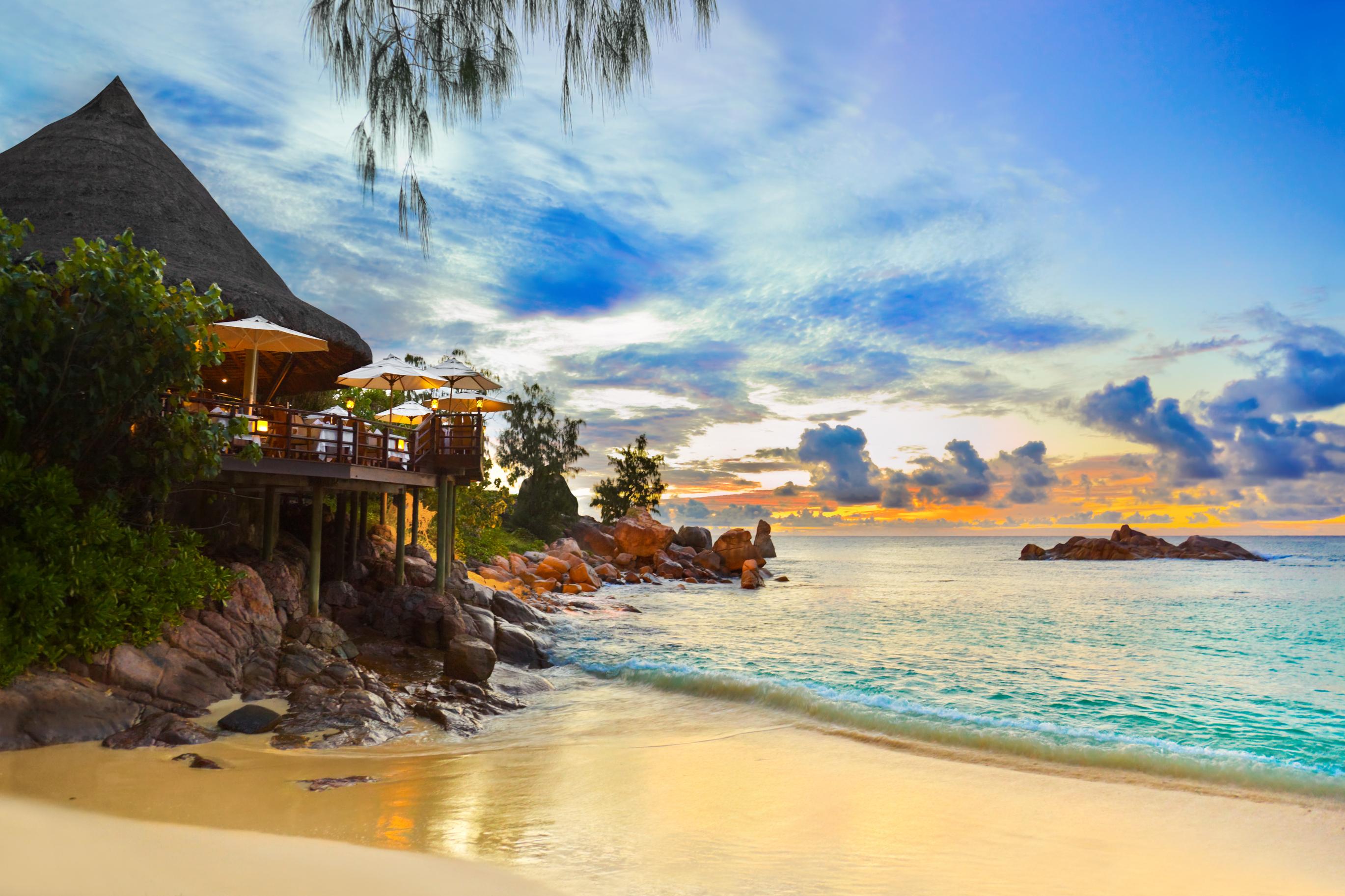 A cafe overlooking a tropical beach