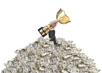 Trophy in pile of money