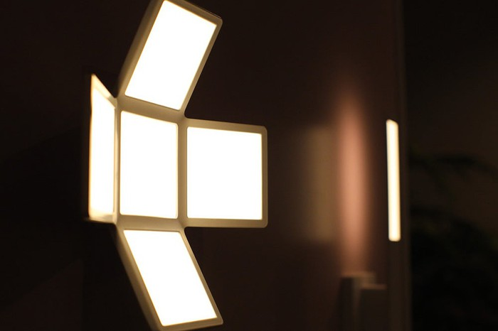 OLED lighting fixture, featuring four square, white panels.