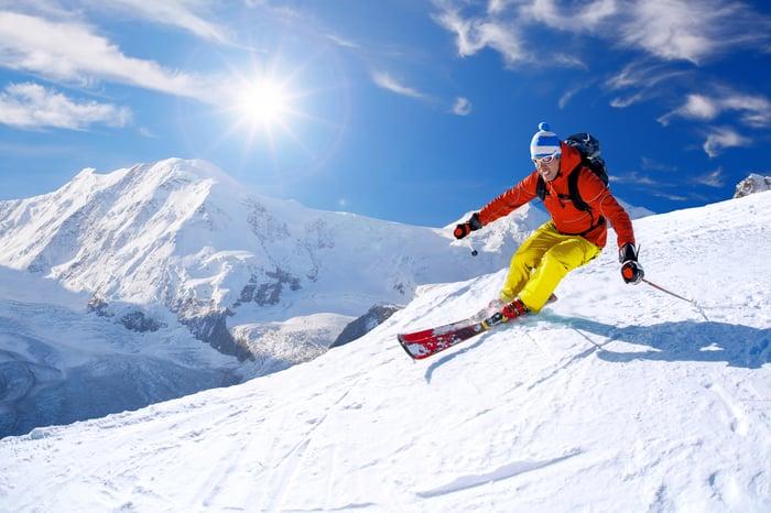 Man skiing down a mountain.