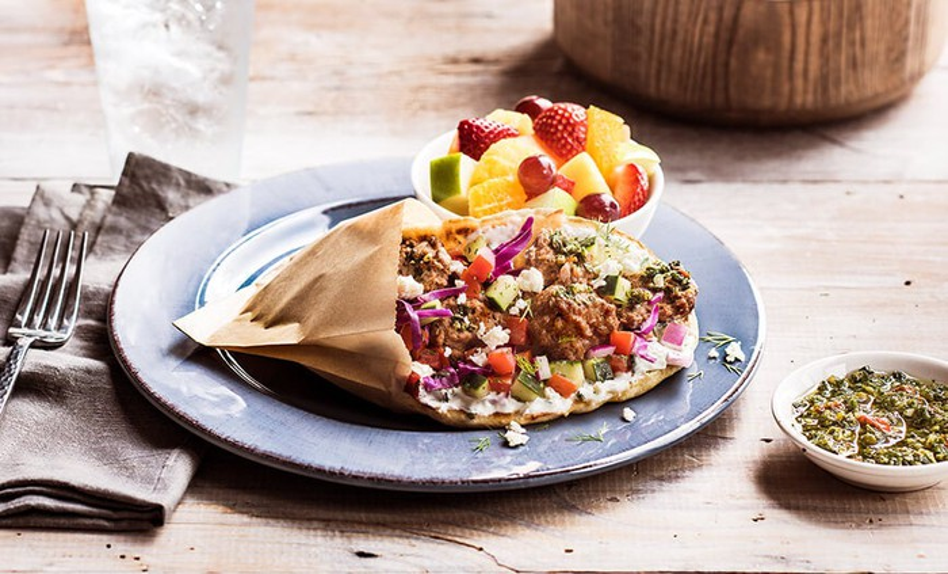 A picture of Zoe's Kitchen lamb pita sandwich.