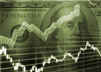 Stock chart in front of $100 bill
