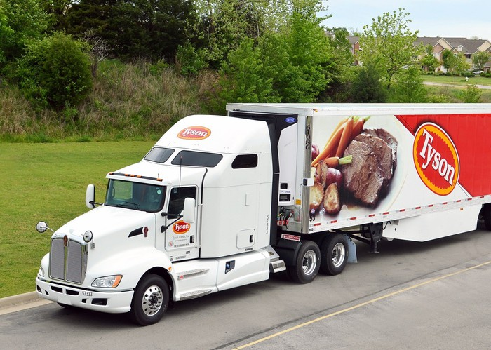 Tyson Foods semi truck with logo and beef dinner product on the side of the tractor trailer