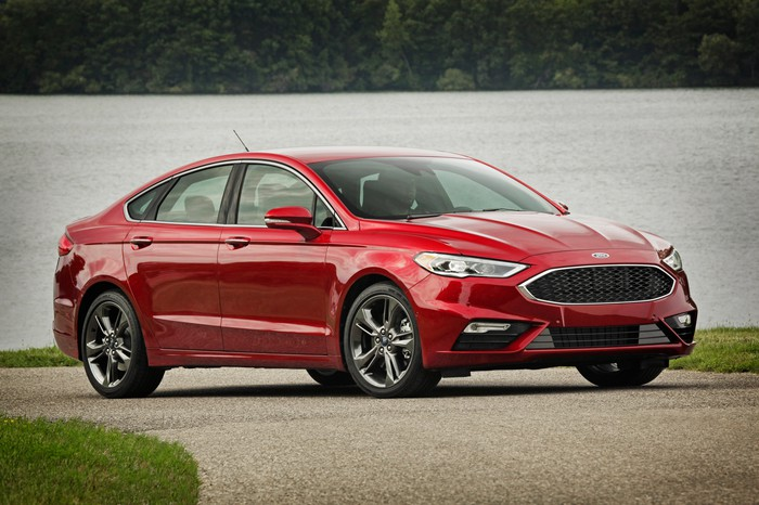 A red 2017 Ford Fusion Sport, a midsize sedan with sporty wheels and trim.