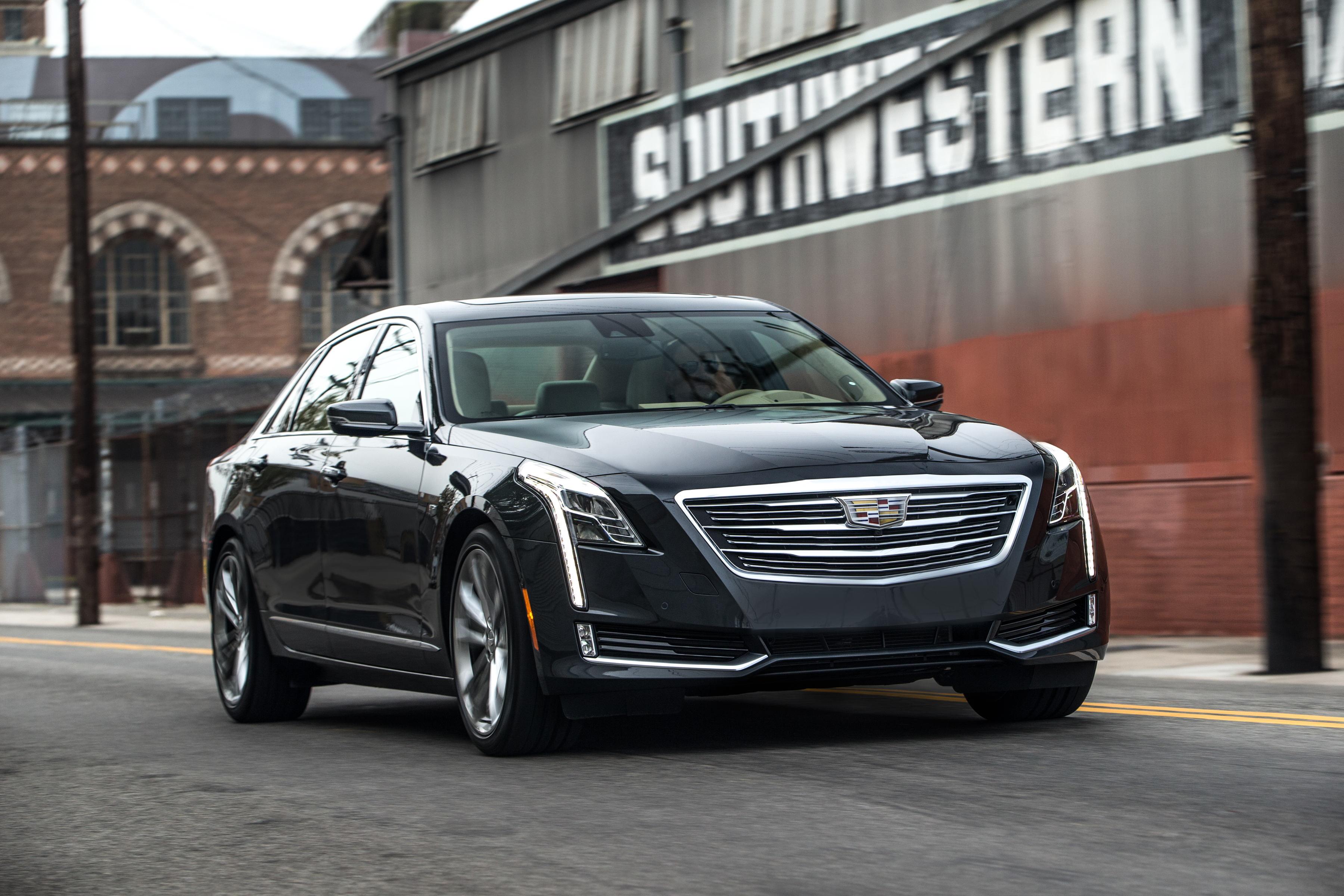 A black 2017 Cadillac CT6, a large luxury sedan, on a city street.