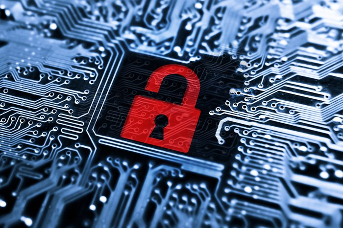 Open red padlock in a circuit board -- concept for computer hacking.