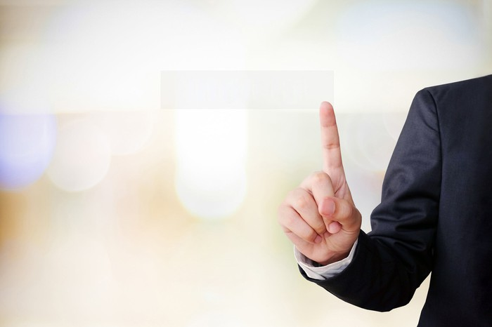 Businessman holding up index finger