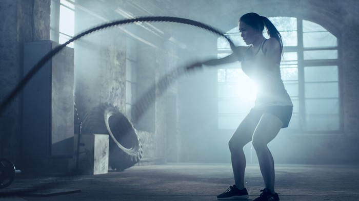 A woman working out with a rope.