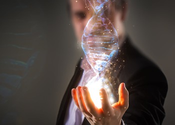 Man holding DNA image in hand