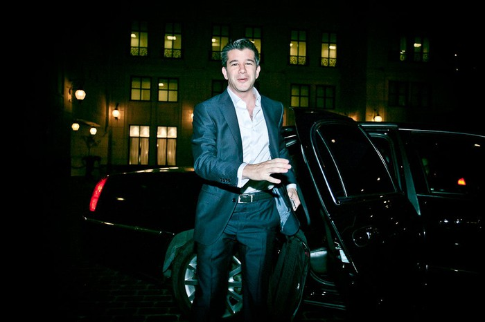 Kalanick is shown getting out of a black sedan in a city at night.