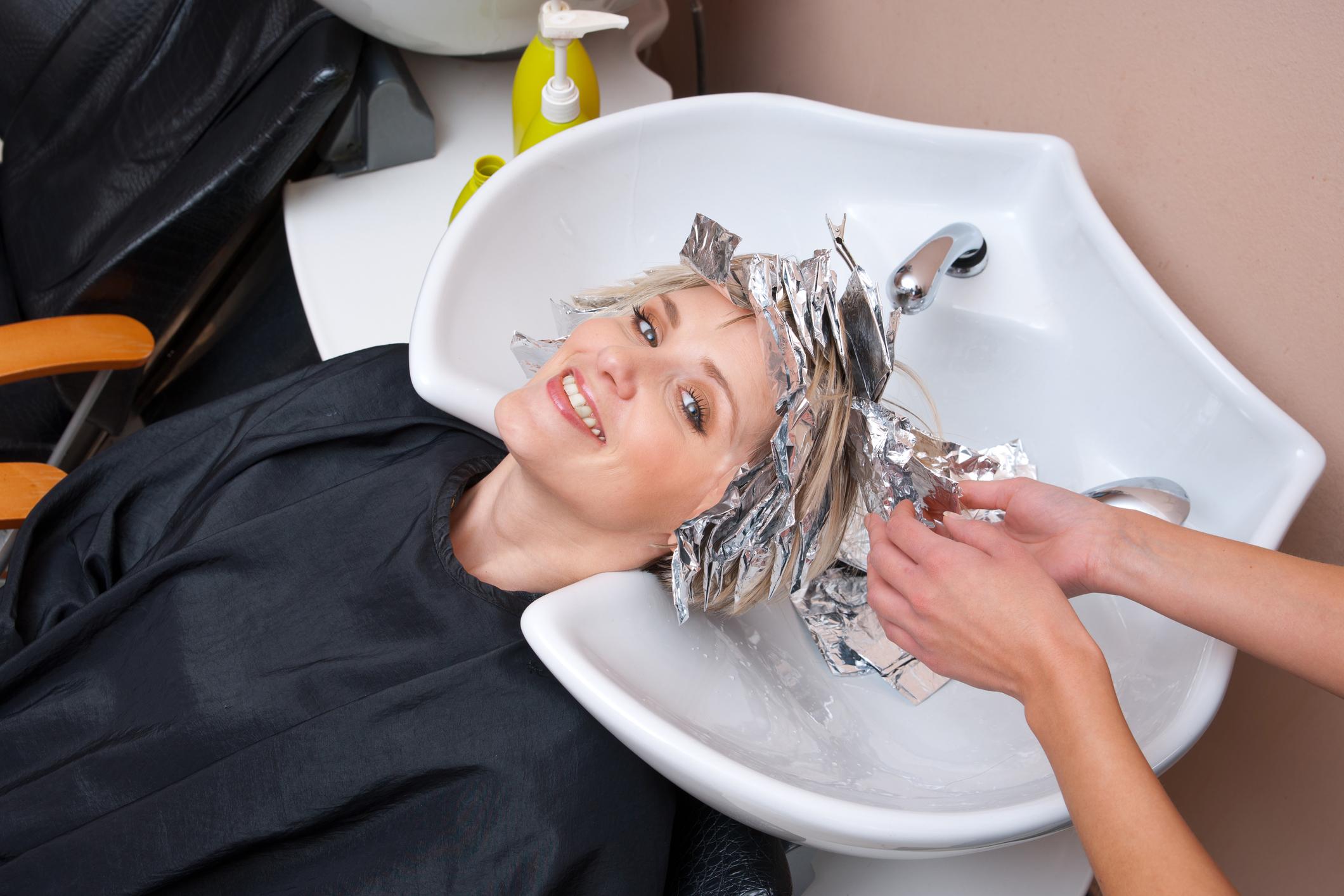 A salon customer having her hair colored