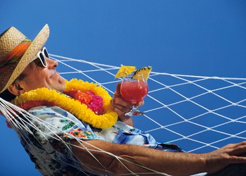 mature man in hammock with drink