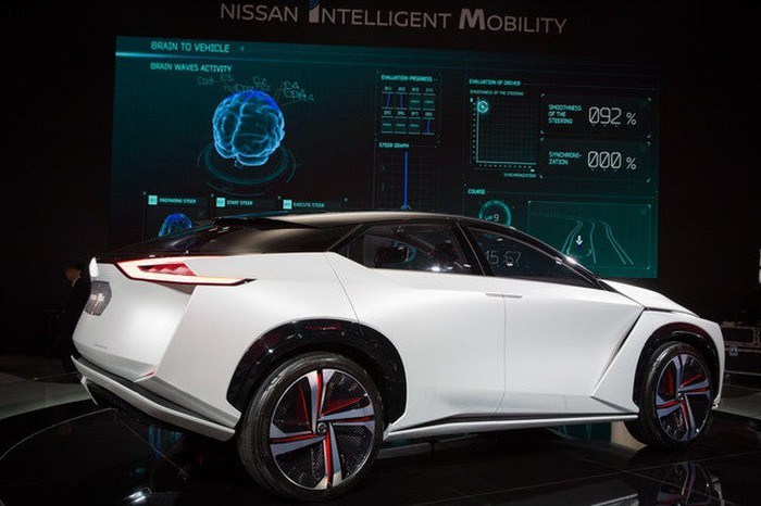 The Nissan IMx all-electric and self-driving crossover, on display at CES 2018. The car is white with black, gray and red rims.