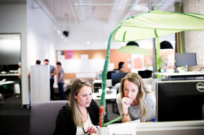 Zendesk employees working at Zendesk offices